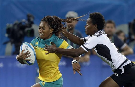 Australia's Ellia Green, left, breaks away from Fiji's Raijieli Daveua, during the women's rugby sevens match between Australia and Fiji at the…