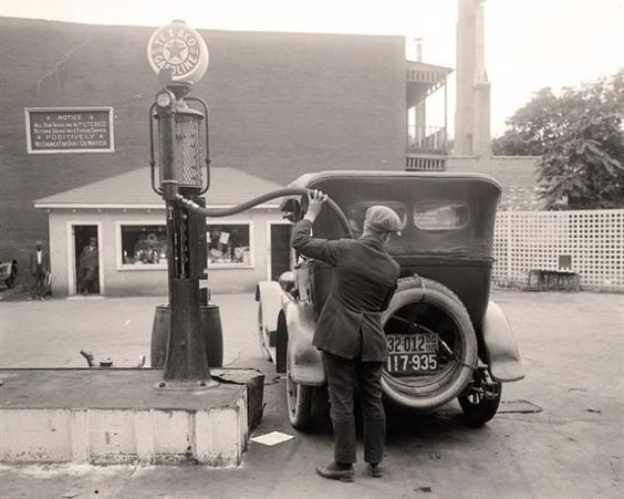 Filling Car With Gas - taken between 1905 and 1945 by Harris & Ewing