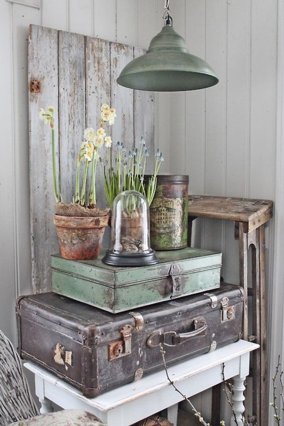 Vintage Suitcase vignette makes for great spring display when you add fresh flowers and a color coordinating industrial light fixture