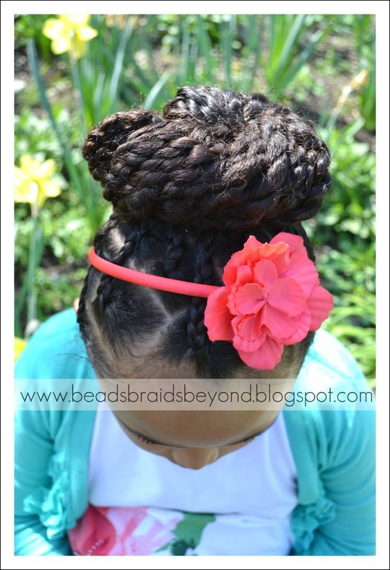 Two Strand Twists with Braided Roots Pulled into a High Bun