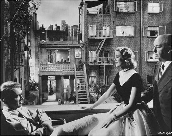 "James Stewart, Grace Kelly & Alfred Hitchcock on the set of ""Rear Window"", 1954."