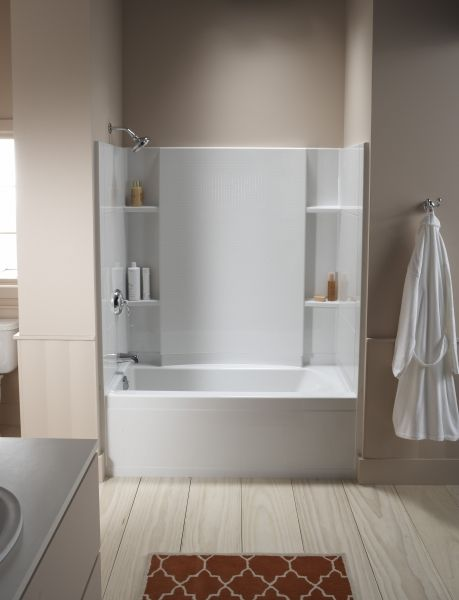 Sterling, Kohler's sister company, offers an attractive alternate for those on a tight budget by designing acrylic tub surrounds with different built-in shelving options. Sterling gives this tub/shower area a clean, transitional look without the need for a custom tile design on the tub/shower walls.