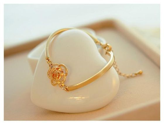A personal favorite from my Etsy shop https://www.etsy.com/listing/266439778/trendy-gold-plated-rose-flower-charm