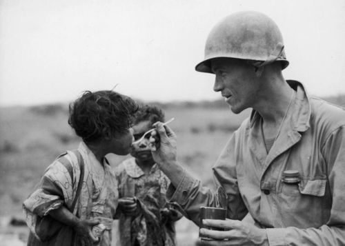 A US Marine feeds children on the island of Okinawa.