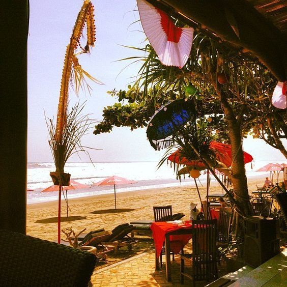 warung bola, Kuta, Indonesia — by Arielle Maia. Warung Bola- great for a bite and a drink on the beach in Seminyak, Bali. Not as crazy as some of the other beachside...