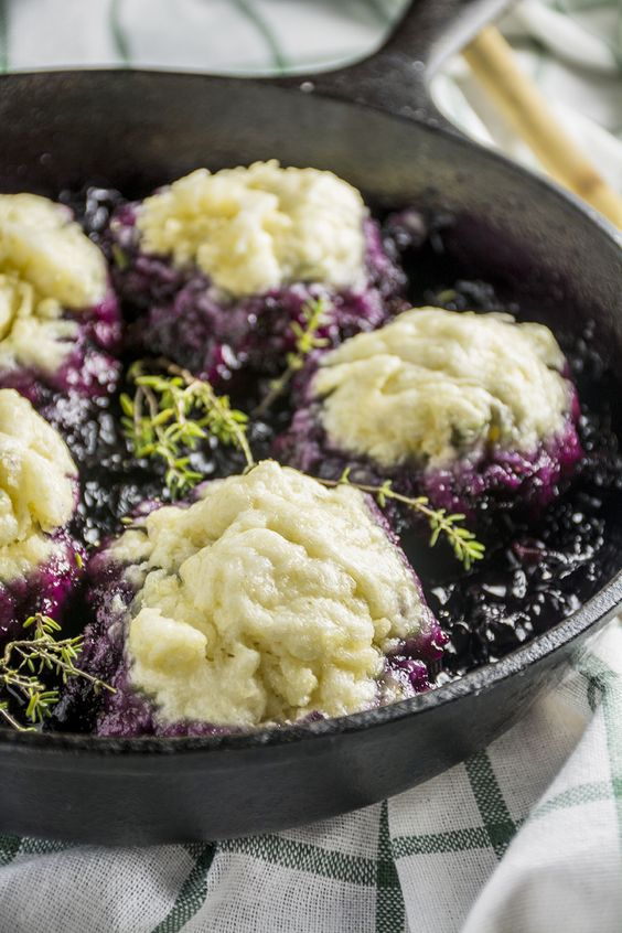 """Blueberry Grunt - A """"grunt' is a cobbler that you cook stove top so the drop biscuit topping steams (dumpling like). The simmering fruit makes a grunting noise as it moves through the biscuit dough."""