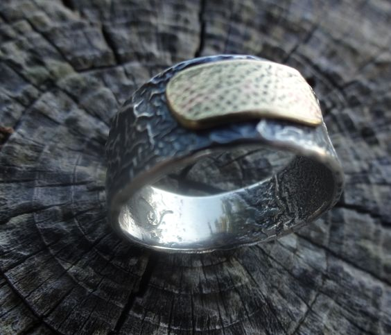 wedding band made using a piece of customer's original gold band as accent for reticulated silver