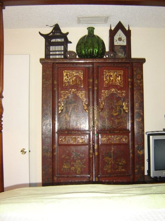 Our Antique Chinese Cabinet. Bought the green bottle to pull the color out of the cabinet, with the new paint color that will be using (Parakeet). Hope it works! We aren't getting rid of this!