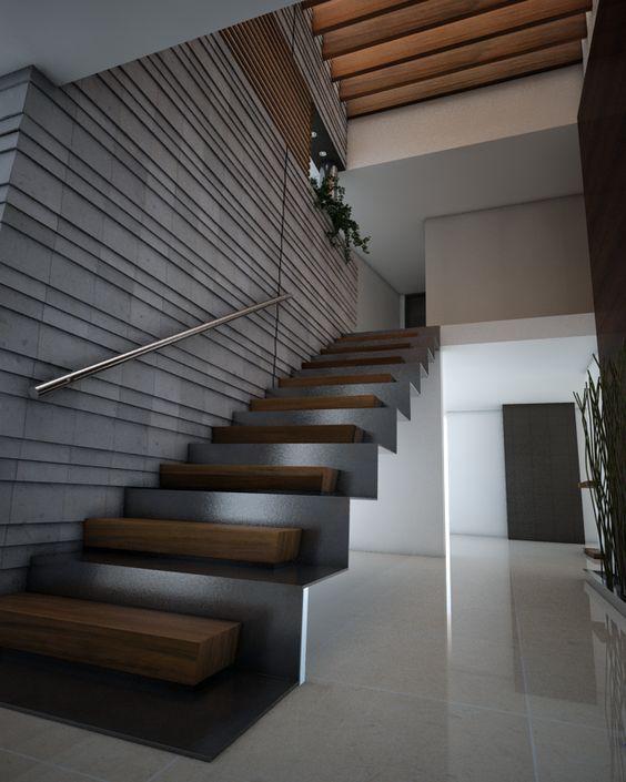 La escalera doble con estructura de acero escalon de - Escaleras interiores de madera ...
