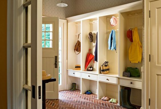 Storage in your entryway cleans up the clutter and makes your doorway look bigger. (Photo: Crisp Architects)