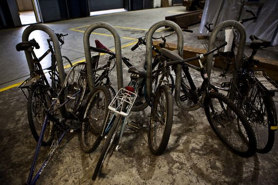 Bicycles still chained to a rack are among the artifacts from the World Trade Center. (Timothy Fadek for The Wall Street Journal)