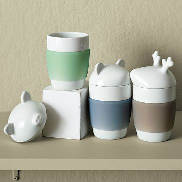 Insulated Animal Mugs: Adorable animal head lids double as a teabag rest. Silicone grip bands protect your fingers from the heat! Made of porcelain $18