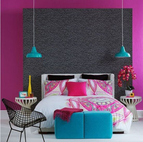 "Super colorful bedroom with neutral flooring and a ""carpeted"" headboard.."