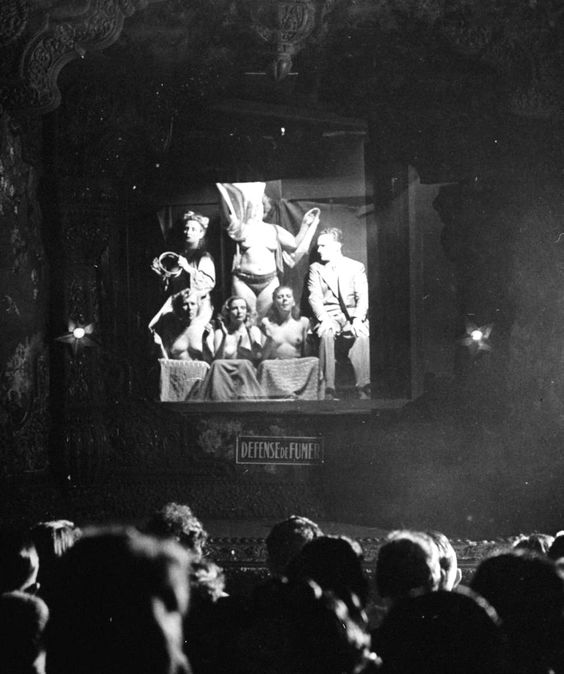 Nude showgirls and a patron on stage at Le Ciel nightclub. Paris 1949. Photograph: Gjon Mili,