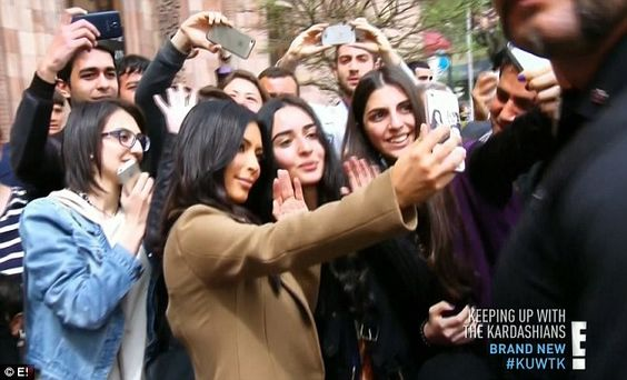 International star: The Kardashians, particularly Kim, were swamped by fans in Armenia...