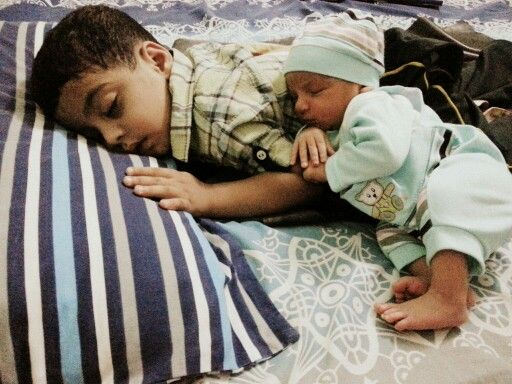 Baby sleeping with elder brother