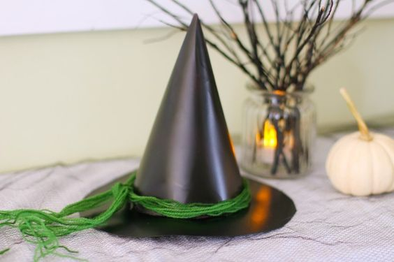 Turn an ordinary birthday party hat and a cereal box into a witch hat in just a few steps! This idea is a great accessory for any witch costume and the perfect solution for your last-minute trick-or-treater. via @pbsparents