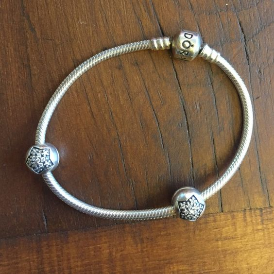 Pandora Bracelet with Spacers Very lightly worn, in amazing condition! Comes with two spacers that have jeweled stars on either side of them. Pandora Jewelry Bracelets