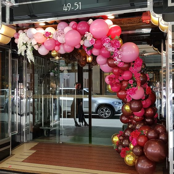 Organic arch in burgundy and pinks using double stuffed custom colour mixes. www.balloons.net.au