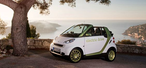 Smart Electric Drive Micro Car. 63-mile range; charges from a standard 220V outlet. Downside: looks like the prize in a very large box of breakfast cereal. Unless you are a cute co-ed you are guaranteed to look stupid while driving this car. Also: site is SUPER VAGUE about whether it is actually available now, and what you're supposed to do (besides sign up for the mailing list) to see one.