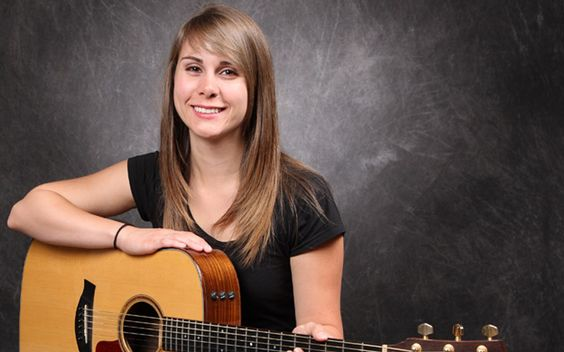 One of our teachers, Molly G. Voice, guitar, Glee, songwriting, and piano teacher, and an accomplished singer-songwriter herself.
