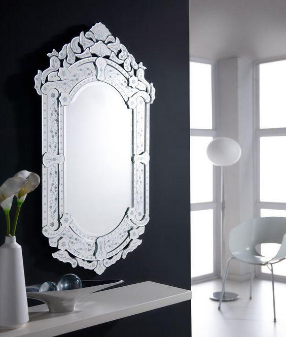 Espejo con marco de lunas plata decoradas soporte en for Espejo marco negro