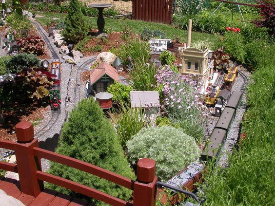 diy backyard train set running through herb garden i am so doing