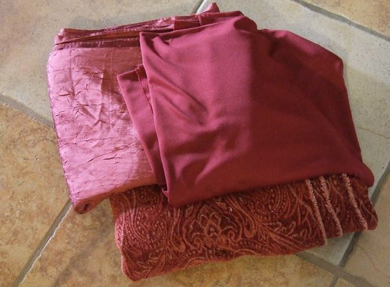 All three fabrics together.  Don't know where the bright pink came from - must have been the lighting.  The silk is definitely a deep burgundy.