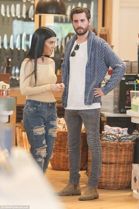 Sharp: Scott looked relaxed in a blue cardigan and grey jeans