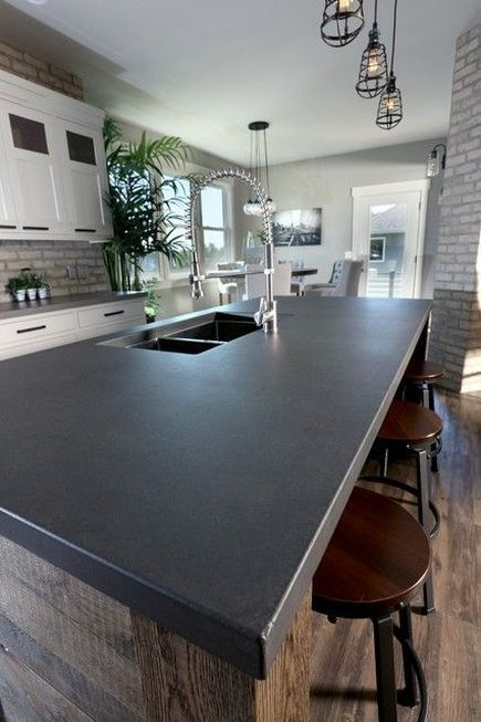concrete countertop on modern, rustic kitchen island