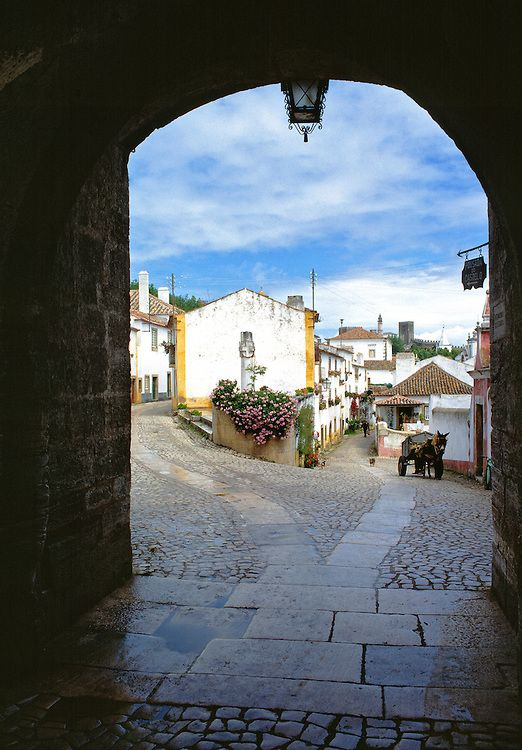 An archway frames this quaint picture in Obidos National Monument, Portugal