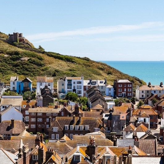 This Vibrant Seaside Town Is A Little Enclave Of Loveliness Home To A Colourful Pier A Thriving Artistic Commu Holiday Cottages Uk Holiday Cottage Holiday Home