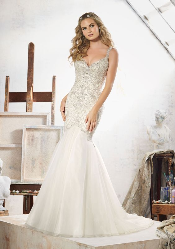 Morilee by Madeline Gardner 'Maeve' 8107 | Glamorous Fit & Flare Wedding Dress Featuring Crystal Beaded Embroidery on Tulle. The Dramatic Open Back is Accented with Covered Button Detail. Colors Available: White/Silver, Ivory/Silver, Light Gold/Silver. Shown in Light Gold/Silver.: