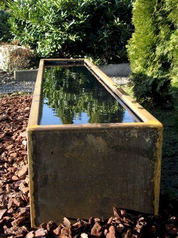 Wasserbecken aus cortenstahl wasserbecken aus edelstahl for Formaler teich