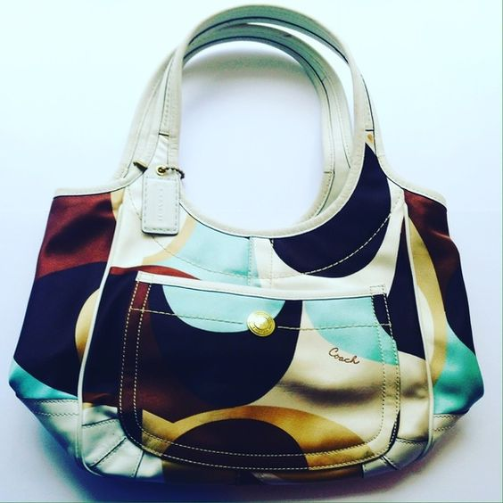 Authentic Coach Handbag Beautiful silky fabric in white, tan, brown, and teal. Slight wear on backside bottom as pictured. There are a few pen marks on the inside, but otherwise super clean and in almost new condition. Coach Bags Shoulder Bags