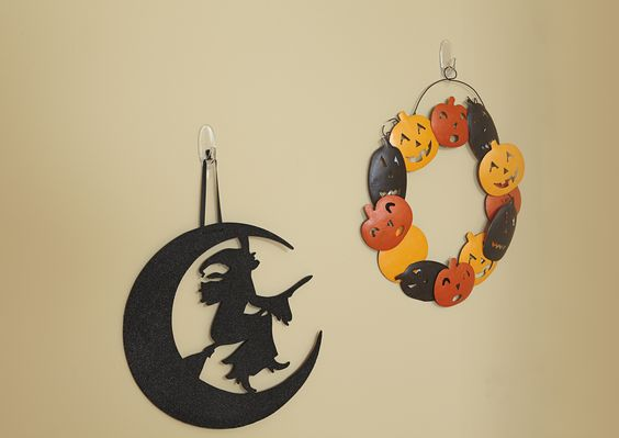 Hang your favorite halloween decorations using Command™ hooks