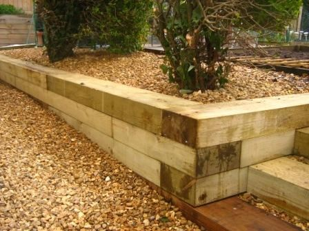 Retaining walls landscape timbers and garden steps on for Wooden garden wall ideas
