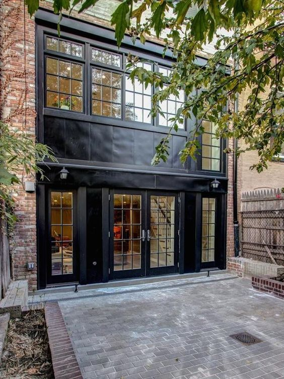 Black Trim And Windows Creates A Dramatic Contrast To A Brick Facade On A Brooklyn Townhouse By