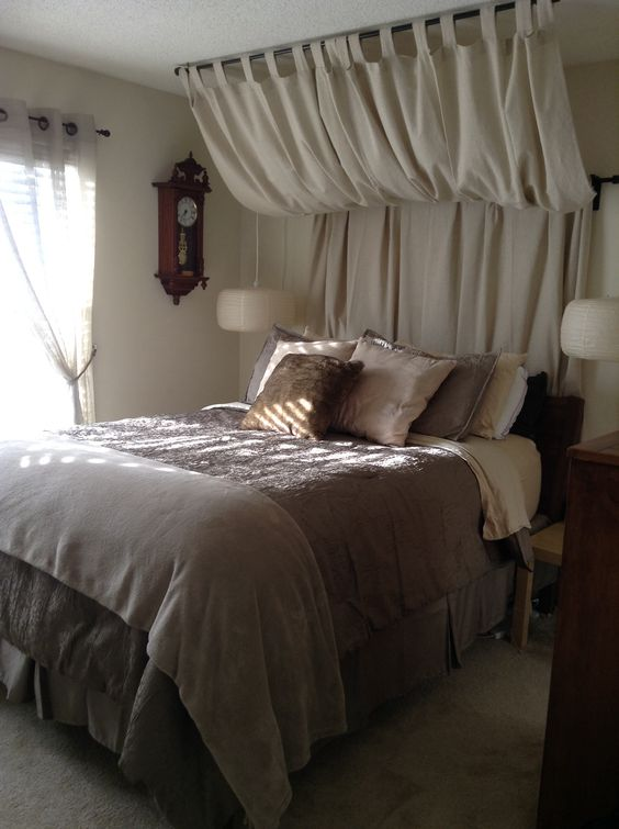 Curtain headboard - perfect to disguise our pipe!