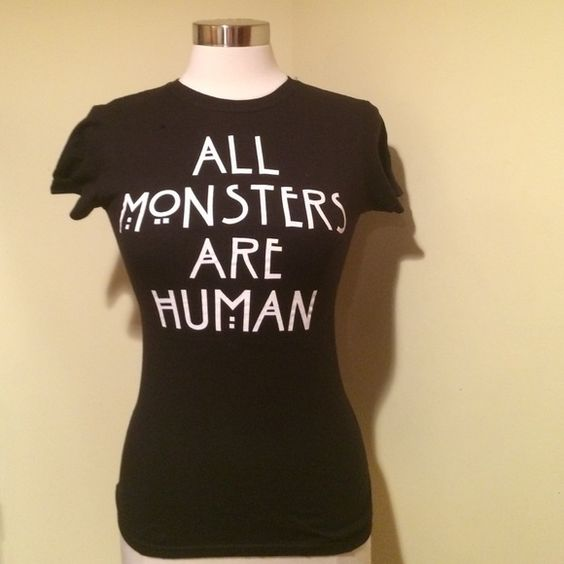 American horror story tee size small but fits more like XS. fitted American horror story tee. Hot Topic Tops Tees - Short Sleeve