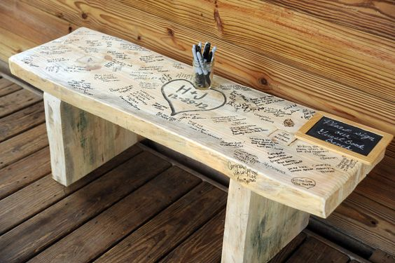 My mom has a very old bench that came from Grandma's shed that is going to be donated to the cause... So much better than the traditional guest book!