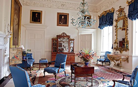 The Dumfries House ~ Upholstered in a custom-woven silk damask and positioned on a mid-18th-century Axminster carpet, the mahogany chairs and settee in the Blue Drawing Room were supplied by Chippendale in 1759; he also created the rare rosewood breakfront bookcase.  The Murano-glass chandelier is original to Dumfries House, the chinoiserie mirror is by William Mathie and the gilt-wood pier table is the work of George Mercer.