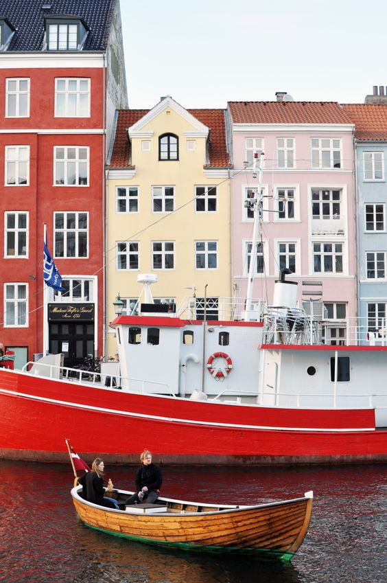 Come to Copenhagen she said. Cruise the classic and colorful Nyhavn Canal in an old fashioned Danish boat. | Learn more about life in the capital of Denmark over at Oregon Girl Around the World