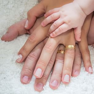 Stack hands. | 29 Adorable Photography Ideas Every Family Should Try