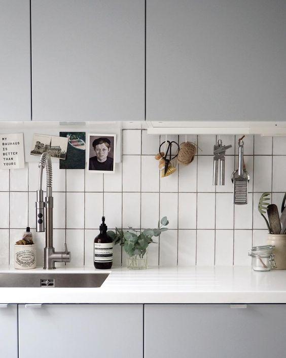 Simple grey kitchen - IKEA kitchen - white metro tiles - utilitarian kitchen - hanging utensils
