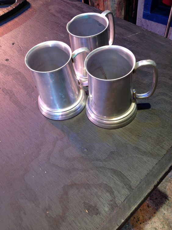 "A closeup of the bar mugs used in the song "" Omm Pa Pa"""