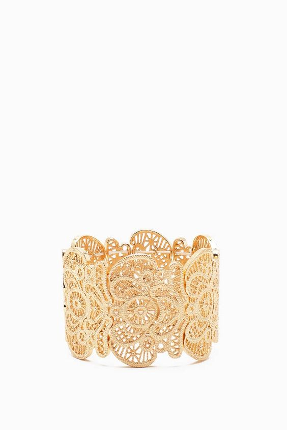 FINAL SALE Classy and always in style, this high polished stretch bracelet is perfect for all your party looks! Lace-like cutouts. Filigree detail.