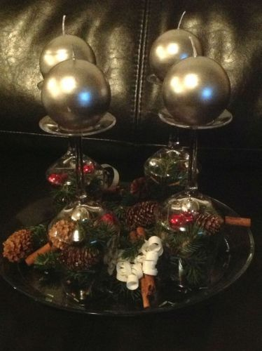 Wine glasses sitting upside down filled with pine cones