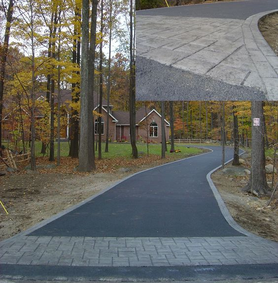 New asphalt driveway with a stamped concrete apron and border.