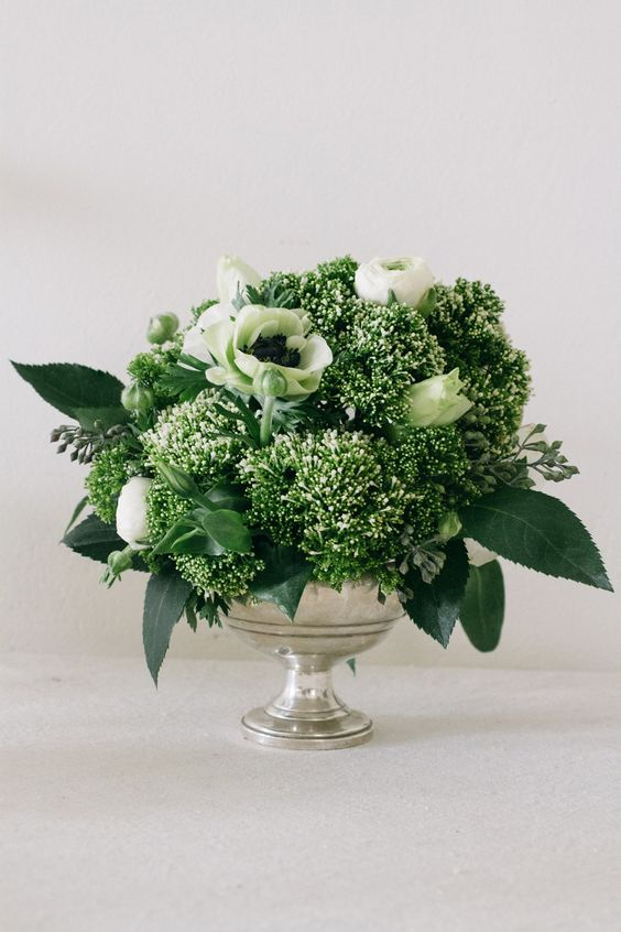Gorgeous green white florals in an antique silver
